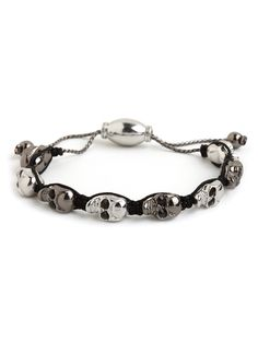 Flaunt your devilish side with this fierce bracelet, which features gorgeous skull-shaped beads in two-tone silver and hematite hues. Upping the ante: those glitzy onyx gems.