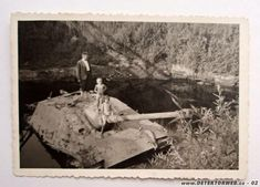 Children playing in a stuck German Jagdpanther.