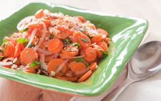 Here's a light and colorful side dish that complements everything from grilled meats to a spring stew to burgers or sandwiches. It is also a perfect, budget-friendly dish for an outdoor party buffet table or potluck as it won't lose its appeal on a warm day. For a slightly earthier flavor substitute up to half the carrots with parsnips.