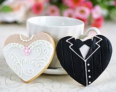 "Wedding Food boda - Tastefully hand-decorated, the Heart Shaped Dress and Tux Cookies are sure to be regarded the ultimate in edible favors; what a sweet-""hearted"" reminder of your Big Day! Cookie Wedding Favors, Cookie Favors, Wedding Desserts, Wedding Cupcakes, Cookie Desserts, Party Favors, Wedding Dress Cookies, Wedding Snacks, Cookie Table"