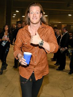 What You Didn't See on TV at the ACMs | TYLER KEEPS IT CASUAL | Getting pumped for the show backstage, Hubbard (of Florida Georgia Line) clutches a blue Solo cup, and we can only imagine what's inside. Our guess? Beer.