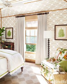 """The """"wow"""" effect of Cowtan & Tout's Bamboo wallpaper is heightened by applied bamboo trim that frames the room and extends onto the ceiling."""