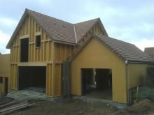 Pose de couverture sur maison ossature bois