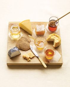 Cheese and honey: Abbaye Sainte Mere, a soft French washed-rind cheese; Petit Langres, a buttery French washed-rind from Champagne; Boerenkaas, a hard Dutch Gouda; and Valencay, a crumbly French goat cheese. Fromage Cheese, Goat Cheese, Cheese Pairings, Wine Pairings, Best Honey, Cheese Party, Wine Cheese, Martha Stewart Weddings, Cheese Platters