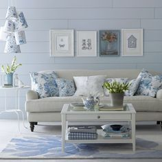 Floral blue living room  This fresh blue and cream colour palette offers a contemporary take on country florals. Mixing a selection of prints creates an eclectic feel.