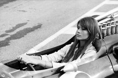 Francoise Hardy sittting in a Formula One race car during the filming of Grand Prix, 1966.