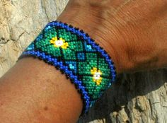 """vintage hand beaded tribal huichol bracelet  peyote"" Love the colors on this.  The center really pops!"