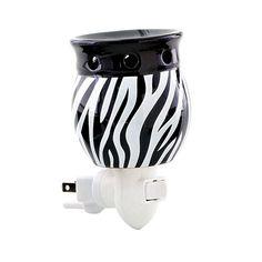 "ZAZA ZEBRA NIGHT LIGHT Ceramic. Fragrance sold separately. 2¾ x 3¾ x 2½"" Item: 93493 $15.00"