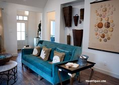 Accessories from The Nest Egg decorate the living room of this 2014 Vintage Township Parade Home.