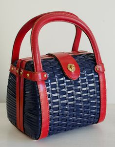 This is either 1950s or 1960s. Adorable Blue and Red Colorblock Basketweave Vintage MOD Box Purse