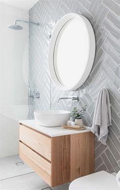 Scandinavian bathroom with herringbone pattern wall tile #ModernBathroomDesign