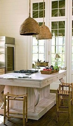 White kitchen with lots of straw colors, love the chandeliers
