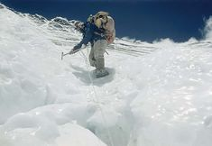 Tenzing Norgay steadies himself with his ice axe as he makes his way down the Lhotse Face