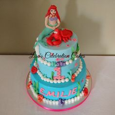 Ariel and Sebastian from The Little Mermaid on a three tiered vanilla and chocolate buttercream filled sponge birthday cake.
