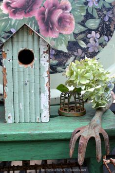 Bird house, bench, vintage garden tool and flower frog with hydrangea blooms…
