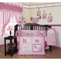 This pink dragonfly 13-piece crib bedding set is a fun choice for any baby girl's room. The set comes with a crib quilt, crib sheet, diaper stacker, toy bag, two window valances, two throw pillows, and more, all in an adorable dragonfly theme.