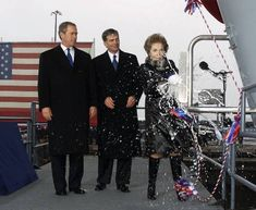 Former First Lady Nancy Reagan christens USS Ronald Reagan with President George W. Bush and Newport News Shipbuilding CEO William Frick looking on, 4 March 2001. The carrier began it's active service in 2013.