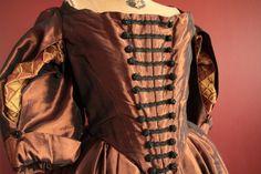 Copper cavalier dress, bodice/sleeve detail.