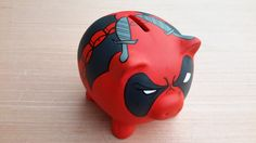 Ceramic piggy bank painted as Deadpool. All banks are 5 inches along and come with a rubber cork so they are reusable.