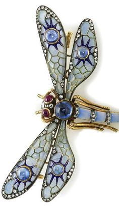 A plique-à-jour enamel, sapphire, ruby and diamond articulated dragonfly brooch.