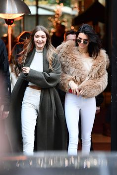Gigi Hadid and Kendall Jenner pair all white with a fur and trench coat and couldn't look cuter.