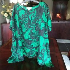 Michael Kors Handkerchief Blouse Michael Kors stricking emerald green and black swirl pattern blouse.....gorgeous colors together!!! Very easy to wear and 100% polyester for easy care...in excellent condition! (true colors in pictures 2 & 4) Michael Kors Tops Blouses
