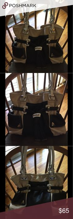EUC Large Cream Black White Leather by Bruce M This is a large leather bag. It tends to be heavy but so stylish,  inside clean. Bruce Makowsky Bags Shoulder Bags