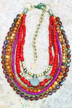 Red Shimmer Necklace: Shimmer and shine this holiday season in this spectacular red coral, amber and magenta multi-strand designer necklace.