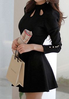 Look effortlessly stunning at a fancy party in this Black Three Keyholes Dress