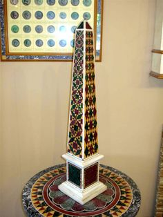 A superb Italian Obelisk, in pietra dura with matching pietra dura round table top.