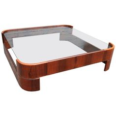 Novo Rumo 1960s Brazilian Jacaranda Coffee Table with Glass Top | From a unique collection of antique and modern coffee and cocktail tables at https://www.1stdibs.com/furniture/tables/coffee-tables-cocktail-tables/