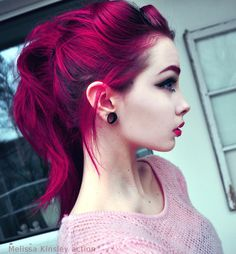 Gorgeous cerise hair (she dyed her eyebrows too: that's class!)