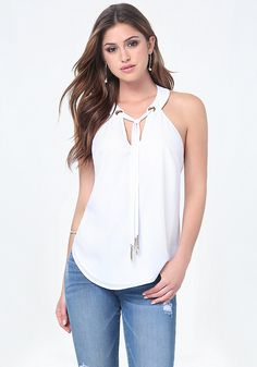 Polished halter top in an airy silhouette. Neckline grommets threaded with chic chain-fringe ties. No closures. Fully lined.