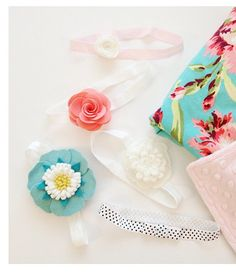 """baby headbands.  just glued a length of FOE elastic together, overlapping the edges (14-15"""" seems to fit through the whole first year),"""