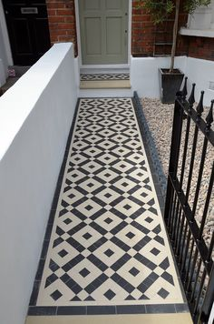 Classic London Front Garden Victorian Black and White Mosaic Tile Path Wrought Iron Metal Gate and Rail Scottish Pebbles Bullnose York Stone Balham London Contact anewgarden for more information Victorian Front Garden, Victorian Front Doors, Victorian Terrace House, Wood Front Doors, Victorian Homes, Victorian Hallway Tiles, Victorian Mosaic Tile, Tiled Hallway, White Pebble Garden