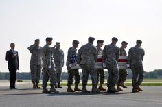Army Secretary John McHugh, left, and Army Chief of Staff Gen. Ray Odierno, second from left, and Air Force Col. Richard G. Moore, commander 436th airlift wing, watch as an Army carry team transfers the remains of Army Maj. Gen. Harold Greene at Dover Air Force Base, Del., Thursday, Aug. 7, 2014. Chris Carroll/Stars and Stripes