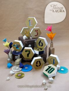 wedding decorations and card board table numbers www.thingsbylaura.co.uk