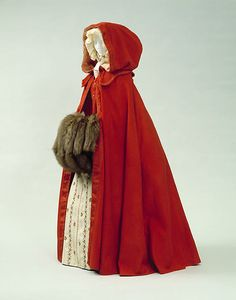 """Cloaks in one form or another were popular items of dress in the American colonies from the time of the early settlers. This particular type of cloak, called a """"cardinal"""" because of its color, is made of a closely woven wool cut on the bias and left with a raw edge along the hem"""