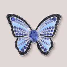 Papillon d'Amazonie clip, Palais de la chance collection White gold, gradation of sapphires, black spinels, turquoise and one pear-shapped sapphire (origin: Sri Lanka). ThePapillon d'Amazonie clipfrom thePalais de la chance collectionpays homage to the radiant colors of the Amazonian butterfly. This enchanting creature is famous for its legendary magical powers.A rare gradation of blue sapphires on the clip depicts the shimmering wings of the magical butterfly.