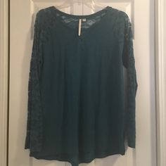 LC Lauren Conrad Sweater w/lace sleeves Size XL Beautiful sweater with lace details from LC Lauren Conrad. Worn two or three times. Like new. Beautiful teal color. Size XL LC Lauren Conrad Sweaters Crew & Scoop Necks