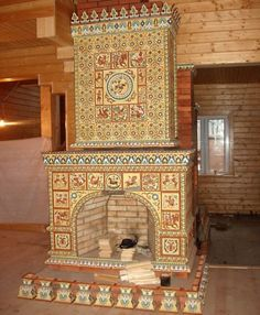 Many stoves along German lines in Russia were decorated with colorful tiles depicting Old Testament characters or instructive stories.  Now fireplaces can be found with floral ornamental tiles.  This fireplace is German/ Russian architecture & masonry work in an upper class household.   (http://www.rollintl.com/roll/grsettle.htm)