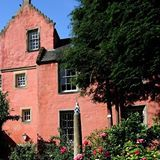Abbot House's stunning coral-coloured exterior is based on the pink building featured in our 16th-century fresco.