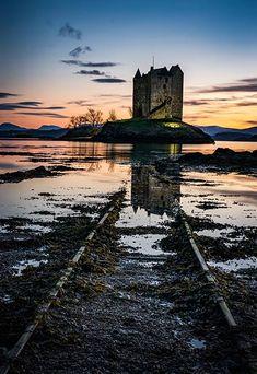 Loch Laich sunset tracks to Castle Stalker, Scotland.