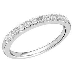 A sparkling Round Brilliant Cut diamond eternity/wedding ring in palladium