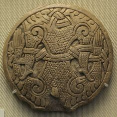 Mammen style Viking button    Anglo-Scandinavian design in the 'Mammen Style', from London, England.    The design shows a man bound by two snake