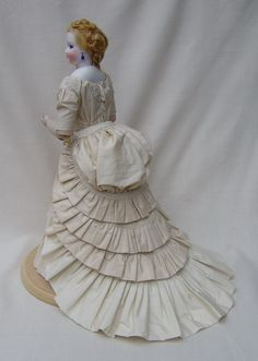 This beauty is dressed to look exactally the way antique dolls were dressed in the 1870's and 1880's.  Paul's eye for beauty, color and detail is unmatched in this divine creation.  Can't you just imagine waltzing in the moonlight in a gown like this?  BRAVO PAUL!!!