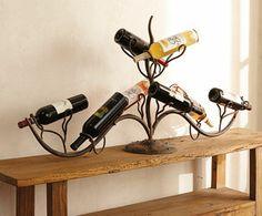 "Napa Style - Wine Vine Bottle Rack. Hand-forged iron (49"" x 10"" x 25""h)"