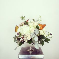 A little fall with your fruit. Brown pears, white anemones, hydrangea, dusty miller