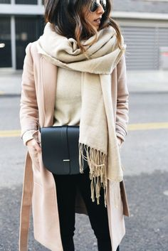 Beautiful pink coat with a neutral scarf and sweater, black jeans and bag.