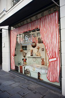 Window Shopping - love the painted window framing curtains